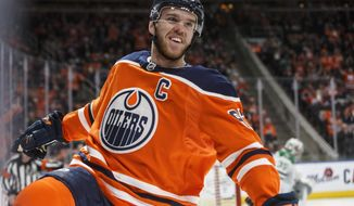 Edmonton Oilers' Connor McDavid (97) celebrates a goal against the Dallas Stars during second-period NHL hockey game action in Edmonton, Alberta, Thursday March 28, 2019. (Jason Franson/The Canadian Press via AP)