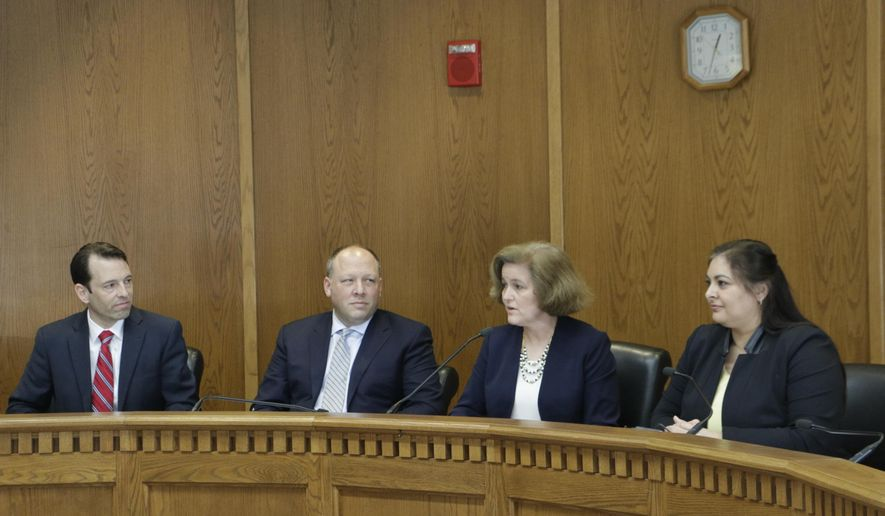 Senate Majority Leader Andy Billig and Sens. David Frockt, Christine Rolfes and Manka Dhingra, left to right, discuss a two-year budget proposal in Olympia, Wash., on Friday, March 29, 2019. The Senate and House are moving through the process of passing their proposals through their respective chambers before moving to negotiations on a final budget plan. (AP Photo/Rachel La Corte)