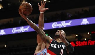 Portland Trail Blazers guard Damian Lillard (0) goes in for a basket in the first half of an NBA basketball game against the Atlanta Hawks, Friday, March 29, 2019, in Atlanta. (AP Photo/John Bazemore)