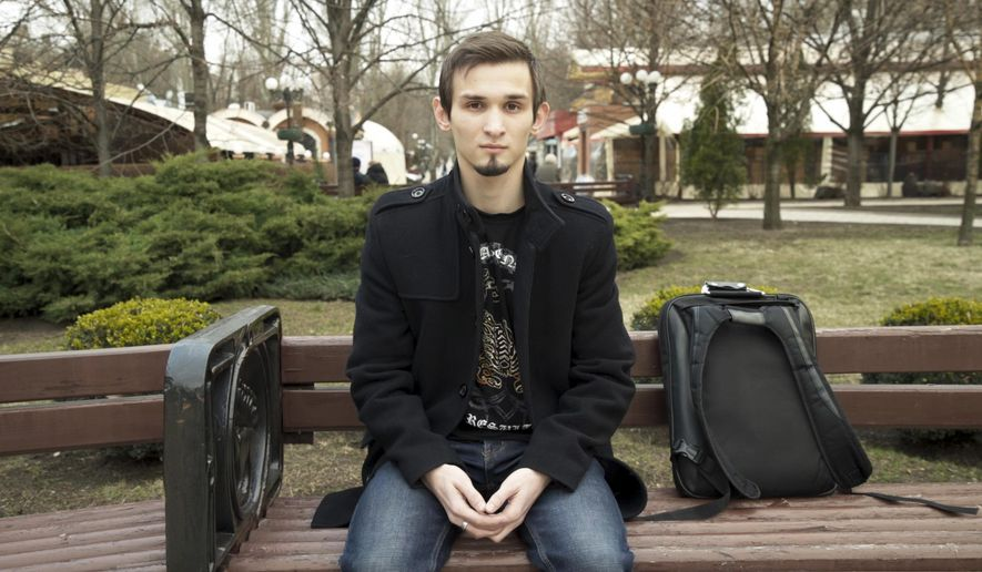 In this image made from video taken on Wednesday, March 27, 2019, university student Maxim Kaluga, 21, speaks to the Associated Press in Donetsk, Ukraine. Five years after a deadly separatist conflict broke out in eastern Ukraine, a generation of first-time voters in rebel-held Donetsk and Luhansk has been cut off from Ukraine's presidential election on Sunday, March 31. (AP photo)