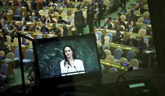 A studio monitor broadcast live Angelina Jolie, United Nations High Commissioner for Refugees specialenvoy, as she address a meeting on U.N. peacekeeping at U.N. headquarters, Friday, March 29, 2019. (AP Photo/Bebeto Matthews)