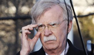 "FILE - In this March 5, 2019, file photo, U.S. National Security Adviser John Bolton adjusts his glasses before an interview at the White House in Washington. Bolton is condemning Venezuela President Nicolas Maduro, saying he is using foreign military personnel to stay in power. Bolton further warned external actors _ those outside the Western Hemisphere _ against deploying military assets to Venezuela or anywhere else in the hemisphere. He says the U.S. will view such actions as ""provocative"" and a ""direct threat to international peace and security in the region.""  (AP Photo/Jacquelyn Martin, File)"