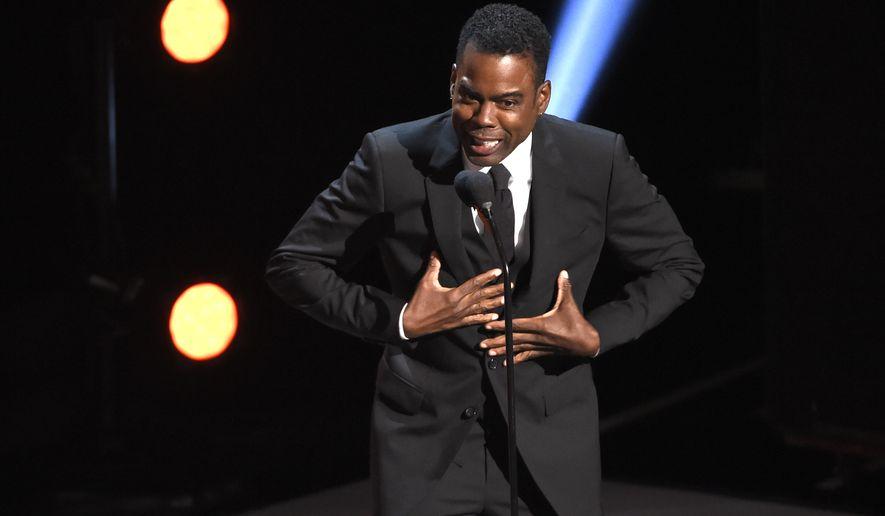 Chris Rock presents the award for outstanding comedy series at the 50th annual NAACP Image Awards on Saturday, March 30, 2019, at the Dolby Theatre in Los Angeles. (Photo by Chris Pizzello/Invision/AP)