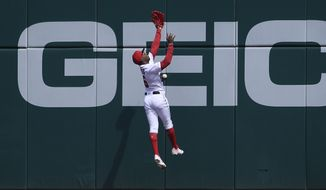 Washington Nationals center fielder Victor Robles misses a ball hit for a triple by New York Mets' Jeff McNeil during the first inning of a baseball game, Saturday, March 30, 2019, in Washington. (AP Photo/Nick Wass)
