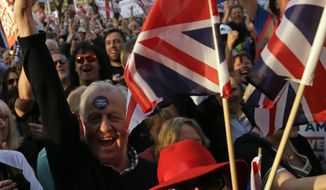 """Pro-Brexit leave the European Union supporters attend a rally in Parliament Square after the final leg of the """"March to Leave"""" in London, Friday, March 29, 2019. The protest march which started on March 16 in Sunderland, north east England, finishes on Friday March 29 in Parliament Square, London, on what was the original date for Brexit to happen before the recent extension. (AP Photo/Tim Ireland)"""