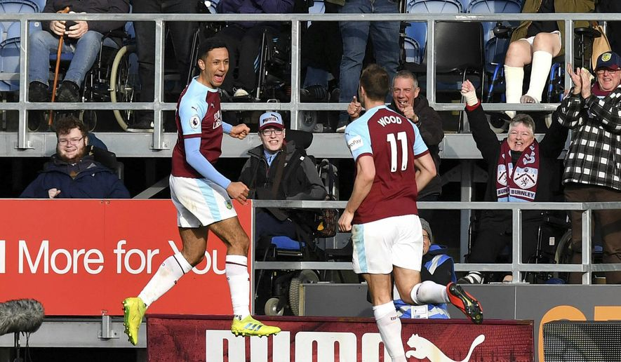 Burnley's Dwight McNeil, left, celebrates scoring his side's second goal of the game during the English Premier League soccer match between Burnley and Wolverhampton Wanderers at the Turf Moor stadium, Burnley, England. Saturday, March. 30, 2019. (Anthony Devlin/PA via AP)