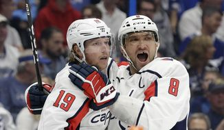Washington Capitals center Nicklas Backstrom (19) celebrates his goal against the Tampa Bay Lightning with left wing Alex Ovechkin (8) during the first period of an NHL hockey game Saturday, March 30, 2019, in Tampa, Fla. (AP Photo/Chris O'Meara) ** FILE **