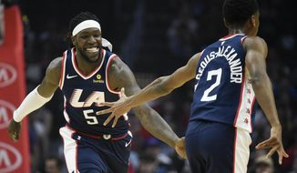 Los Angeles Clippers forward Montrezl Harrell, left, celebrates with guard Shai Gilgeous-Alexander after making a basket during the first half of an NBA basketball game against the Cleveland Cavaliers in Los Angeles, Saturday, March 30, 2019. (AP Photo/Kelvin Kuo)