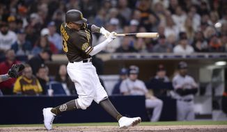 San Diego Padres' Manny Machado singles during the fifth inning of the team's baseball game against the San Francisco Giants on Friday, March 29, 2019, in San Diego. (AP Photo/Orlando Ramirez)