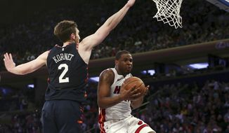 New York Knicks forward Luke Kornet (2) defends against Miami Heat guard Dion Waiters (11) during the first half of an NBA basketball game Saturday, March 30, 2019, in New York. (AP Photo/Nicole Sweet)