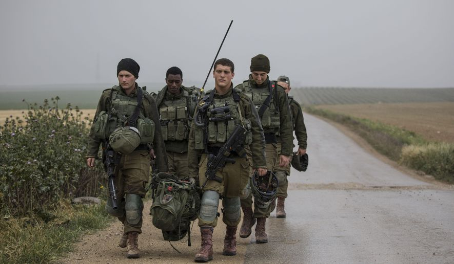 Israeli soldiers deploy on the Israel and Gaza border during a Palestinian protest, Saturday, March 30, 2019. (AP Photo/Tsafrir Abayov)
