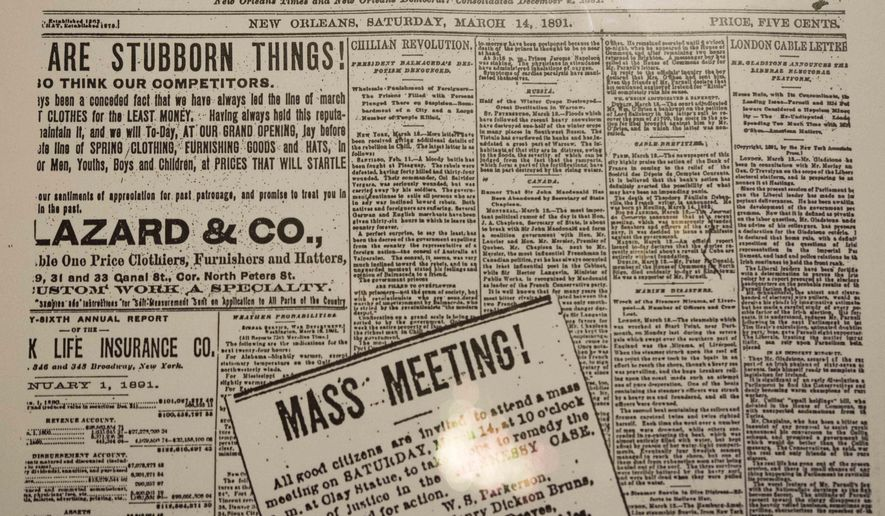 """This photograph, taken Jan. 30, 2016 and provided by AWE News, shows a copy of a March 14, 1891, newspaper advertisement as shown in the Musee Conti Wax Museum exhibit about the lynching of 11 Italian immigrants, three of whom had been acquitted a day earlier in the murder of the city's police chief. The mayor of New Orleans plans an apology to Italian-Americans for what's considered the nation's largest lynching _ violence in which 11 Italian immigrants were killed after acquittals in a police chief's murder.  """"This has been a longstanding wound,"""" said Michael Santo of the Order Sons and Daughters of Italy. The lynching in 1891 and responses to it prompted Italy to close its U.S. embassy, followed by a reciprocal U.S. embassy closing, he said.  (AWE News via AP)"""