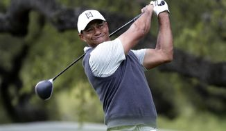 Tiger Woods watches his drive on the eighth hole during fourth round play at the Dell Technologies Match Play Championship golf tournament, Saturday, March 30, 2019, in Austin, Texas. (AP Photo/Eric Gay)