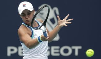 Ashleigh Barty, of Australia, returns to Carolina Pliskova, of the Czech Republic, during the singles final of the Miami Open tennis tournament, Saturday, March 30, 2019, in Miami Gardens, Fla. (AP Photo/Lynne Sladky)