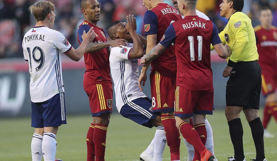 Real Salt Lake midfielder Damir Kreilach (8) heads-butts FC Dallas midfielder Carlos Gruezo during an MLS soccer match Saturday, March 30, 2019, in Sandy, Utah. (Jeffrey D. Allred/The Deseret News via AP)