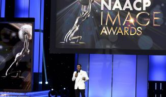 FILE - This Jan. 15, 2018 file photo shows Anthony Anderson hosting the 49th annual NAACP Image Awards in Pasadena, Calif. The 50th NAACP Image Awards ceremony will be held on March 30. (Photo by Chris Pizzello/Invision/AP, File)
