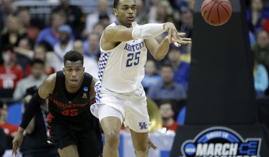 Kentucky's PJ Washington (25) passes as Houston's Fabian White Jr. gives chase during the second half of a men's NCAA tournament college basketball Midwest Regional semifinal game Friday, March 29, 2019, in Kansas City, Mo. (AP Photo/Charlie Riedel)