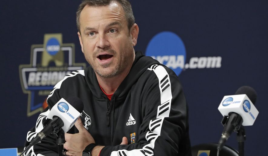 Louisville head coach Jeff Walz speaks to the media during a press conference for the NCAA women's college basketball tournament, Saturday, March 30, 2019, in Albany, N.Y. Top-ranked Louisville faces No. 2 seed Connecticut in the regional final game on Sunday. (AP Photo/Kathy Willens)