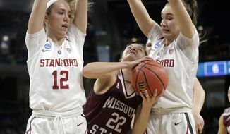 Missouri State's Alexa Willard (22) drives against Stanford's Lexie Hull (12) and Alanna Smith during the first half of a regional semifinal game in the NCAA women's college basketball tournament, Saturday, March 30, 2019, in Chicago. (AP Photo/Kiichiro Sato)