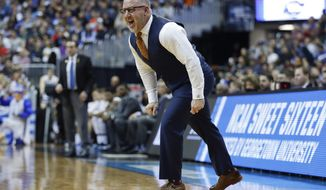 Virginia Tech coach Buzz Williams yells across the court to his players during the first half of the team's NCAA men's college basketball tournament East Region semifinal against Duke in Washington, Friday, March 29, 2019. (AP Photo/Patrick Semansky) ** FILE **