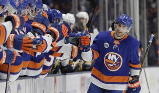 New York Islanders' Jordan Eberle celebrates with teammates after scoring a goal during the first period of an NHL hockey game against the Buffalo Sabres Saturday, March 30, 2019, in Uniondale, N.Y. (AP Photo/Frank Franklin II)