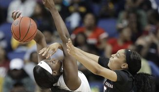 South Carolina's Victaria Saxton (5) knocks the ball from Baylor's Kalani Brown (21) during the first half of a regional women's college basketball game in the NCAA Tournament in Greensboro, N.C., Saturday, March 30, 2019. (AP Photo/Chuck Burton)
