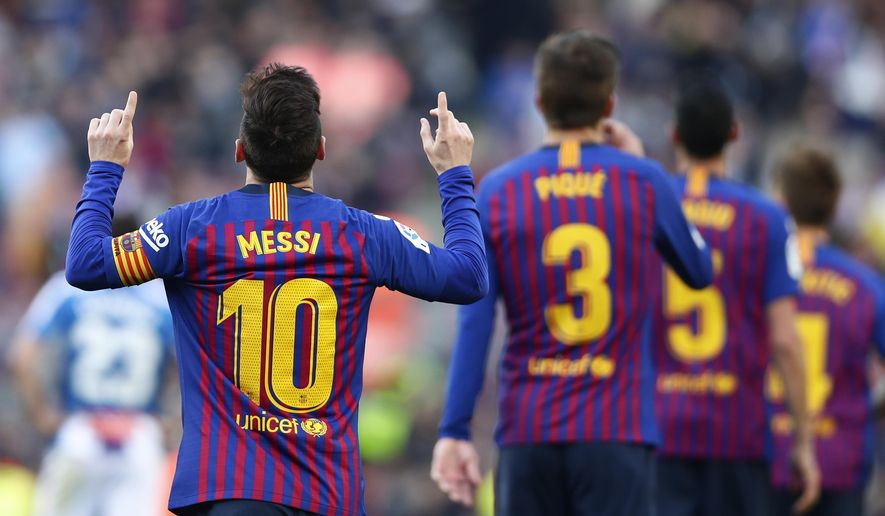 Barcelona's Lionel Messi, left, celebrates after scoring his side's second goal during a Spanish La Liga soccer match between FC Barcelona and Espanyol at the Camp Nou stadium in Barcelona, Spain, Saturday March 30, 2019. (AP Photo/Manu Fernandez)