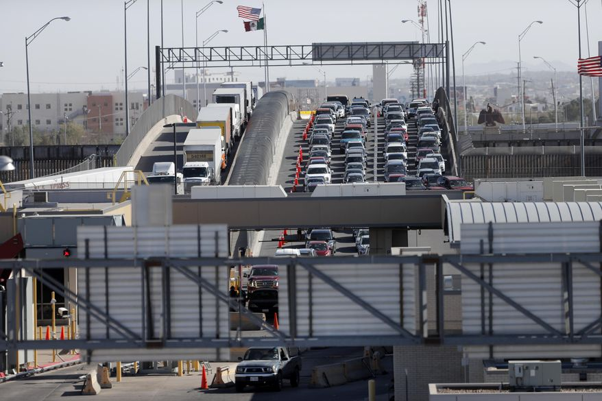 """Cars and trucks line up to enter the U.S. from Mexico at a border crossing in El Paso, Texas, Friday, March 29, 2019. Threatening drastic action against Mexico, President Donald Trump declared on Friday that he is likely to shut down America's southern border next week unless Mexican authorities immediately halt all illegal immigration. Such a severe move could hit the economies of both countries, but the president emphasized, """"I am not kidding around."""" (AP Photo/Gerald Herbert)"""
