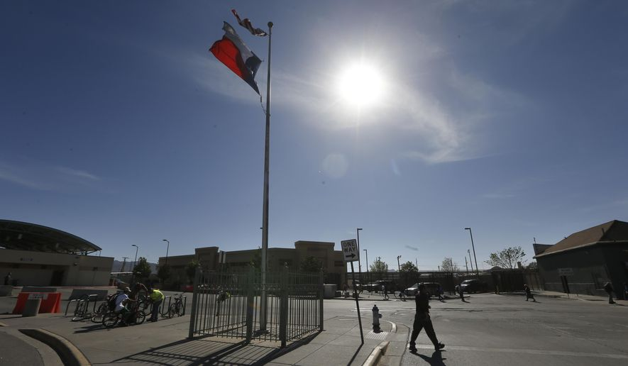 A person crosses the street at a U.S.-Mexico border crossing in El Paso, Texas, Friday, March 29, 2019. (Associated Press) ** FILE **