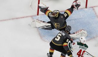 Minnesota Wild left wing Kevin Fiala, bottom left, scores on Vegas Golden Knights goaltender Malcolm Subban during the second period of an NHL hockey game Friday, March 29, 2019, in Las Vegas. (AP Photo/John Locher)