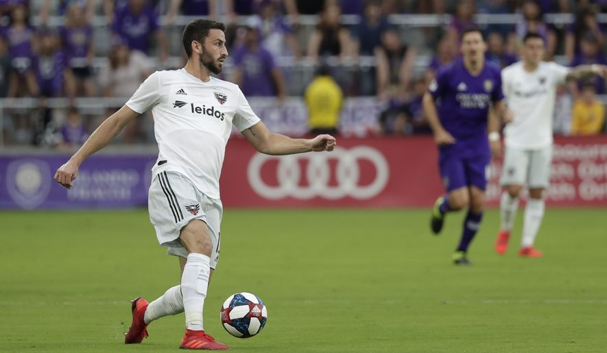 D.C. United's Steve Birnbaum moves the ball against Orlando City during the first half of an MLS soccer match, Sunday, March 31, 2019, in Orlando, Fla. (AP Photo/John Raoux)