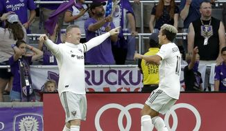 D.C. United's Wayne Rooney, left, celebrates his goal against Orlando City with teammate Lucas Rodriguez during the first half of an MLS soccer match Sunday, March 31, 2019, in Orlando, Fla. (AP Photo/John Raoux)