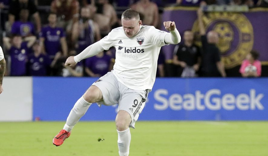 D.C. United's Wayne Rooney moves the ball against Orlando City during the second half of an MLS soccer match, Sunday, March 31, 2019, in Orlando, Fla. (AP Photo/John Raoux) ** FILE **