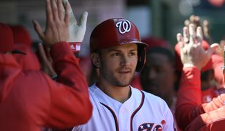 Washington Nationals' Trea Turner celebrates his three-run home run in the dugout during the third inning of a baseball game against the New York Mets, Sunday, March 31, 2019, in Washington. (AP Photo/Nick Wass)