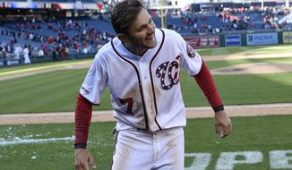 Washington Nationals' Trea Turner reacts after a baseball game against the New York Mets, Sunday, March 31, 2019, in Washington. Turner hit a walkoff home run to win the game in the ninth. The Nationals won 6-5. (AP Photo/Nick Wass)