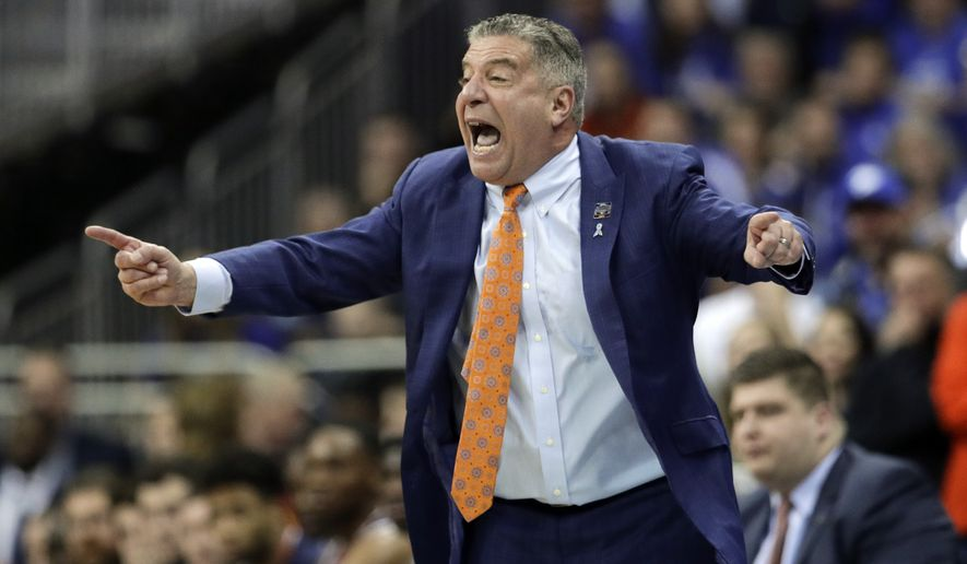 Auburn head coach Bruce Pearl yells from the sidelines during the first half of the Midwest Regional final game against Kentucky in the NCAA men's college basketball tournament Sunday, March 31, 2019, in Kansas City, Mo. (AP Photo/Charlie Riedel)