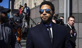 In this March 26, 2019, file photo, Actor Jussie Smollett leaves the Leighton Criminal Courthouse in Chicago after prosecutors dropped all charges against him. Smollett was indicted on 16 felony counts related to making a false report that he was attacked by two men who shouted racial and homophobic slurs. (Ashlee Rezin/Chicago Sun-Times via AP, File)