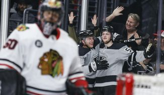 Los Angeles Kings forward Austin Wagner (51) celebrates his goal with forward Jonny Brodzinski (76) during the second period of an NHL hockey game against Chicago Blackhawks on Saturday, March 30, 2019, in Los Angeles. (AP Photo/Ringo H.W. Chiu)