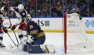 Buffalo Sabres goalie Linus Ullmark (35) is scored against by Columbus Blue Jackets forward Pierre-Luc Dubois (18) during the first period of an NHL hockey game Sunday, March 31, 2019, in Buffalo, N.Y. (AP Photo/Jeffrey T. Barnes)