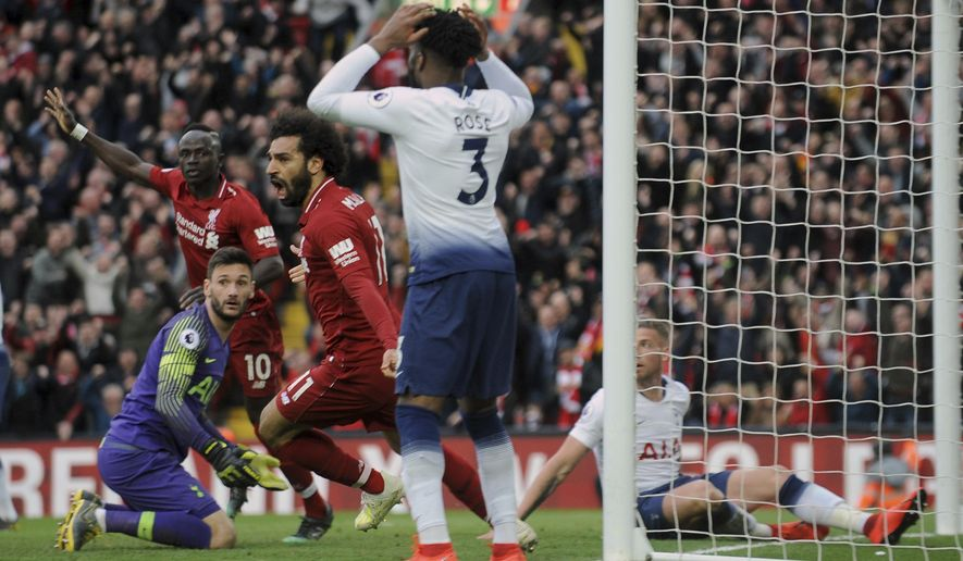 Liverpool's Mohamed Salah, center, celebrates after Tottenham's Toby Alderweireld scores an own goal past his goalkeeper during the English Premier League soccer match between Liverpool and Tottenham Hotspur at Anfield stadium in Liverpool, England, Sunday, March 31, 2019. (AP Photo/Rui Vieira)