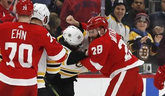 Boston Bruins center Noel Acciari (55) and Detroit Red Wings right wing Luke Witkowski (28) fight during the second period of an NHL hockey game, Sunday, March 31, 2019, in Detroit. (AP Photo/Carlos Osorio)
