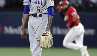 Chicago Cubs' Carl Edwards Jr. looks to the plate as Texas Rangers' Joey Gallo rounds the bases on his three-run home run off of Edwards during the eighth inning of a baseball game in Arlington, Texas, Saturday, March 30, 2019. The Rangers won 8-6. (AP Photo/Tony Gutierrez)