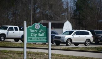 This March 17, 2019 photo, shows parking at Three Way City Hall, a temporary building located next to Pine Hill Park, in Three Way, Tenn. (Adam Friedman/The Jackson Sun via AP)