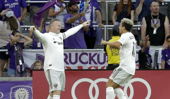 D.C. United's Wayne Rooney, left, celebrates his goal against Orlando City with teammate Lucas Rodriguez during the first half of an MLS soccer match Sunday, March 31, 2019, in Orlando, Fla. (AP Photo/John Raoux) ** FILE **