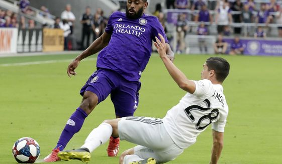D.C. United's Joseph Mora, right, collides with Orlando City's Ruan, left, going after the ball during the first half of an MLS soccer match, Sunday, March 31, 2019, in Orlando, Fla. Mora was injured in the play and left the match. (AP Photo/John Raoux) ** FILE **