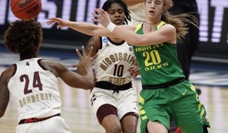 Oregon guard Sabrina Ionescu, right, passes the ball as Mississippi State guards Jordan Danberry, left, and Jazzmun Holmes, center, defend during the first half of a regional final in the NCAA women's college basketball tournament Sunday, March 31, 2019, in Portland, Ore. (AP Photo/Steve Dipaola)