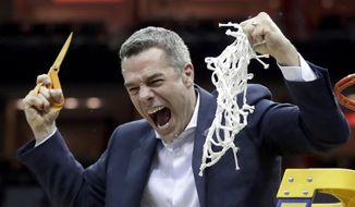Virginia head coach Tony Bennett celebrates after defeating Purdue 80-75 in overtime of the men's NCAA Tournament college basketball South Regional final game, Saturday, March 30, 2019, in Louisville, Ky. (AP Photo/Michael Conroy) **FILE**