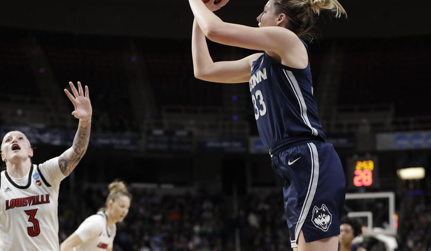 Louisville forward Sam Fuehring (3)defends as Connecticut guard Katie Lou Samuelson (33)shoots from the perimeter during the first half of a regional championship final in the NCAA women's college basketball tournament, Sunday, March 31, 2019, in Albany, N.Y. (AP Photo/Kathy Willens)
