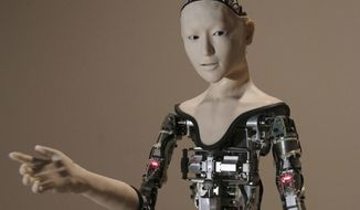 """FILE - This Monday, Aug. 1, 2016 file photo shows the humanoid robot """"Alter"""" on display at the National Museum of Emerging Science and Innovation in Tokyo. Understanding humor may be one of the last things that separates humans from ever smarter machines, computer scientists and linguists say. (AP Photo/Koji Sasahara)"""