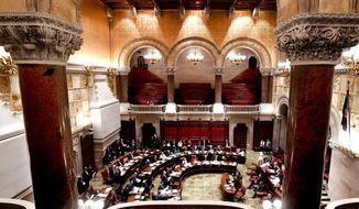 Members of the New York state Senate debate budget bills during session in Senate Chamber at the state Capitol Sunday, March, 31, 2019, in Albany, N.Y. (AP Photo/Hans Pennink)